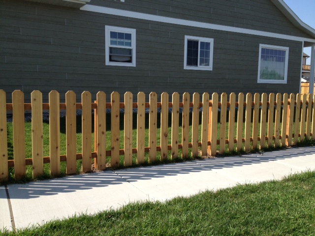 This design has more of an open feel while still keeping Fido from getting loose!  These fences can be stained or painted.