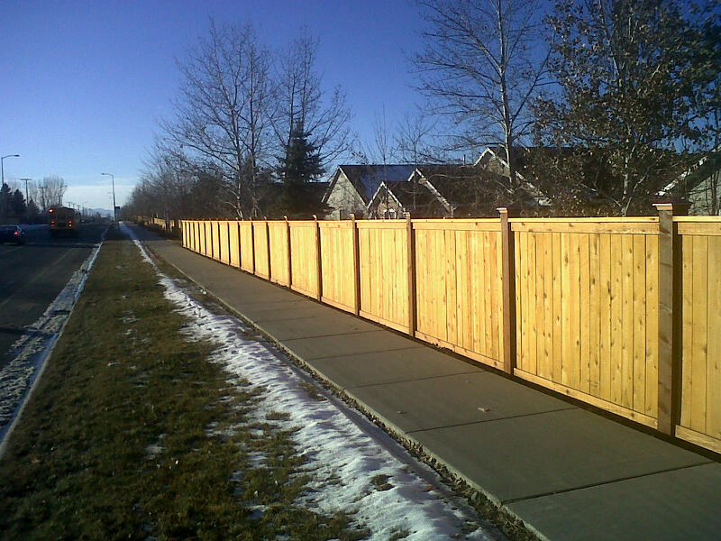 Privacy fences can be built in a variety of styles.  The one shown here has 6x6 posts and is finished off with copper post caps.
