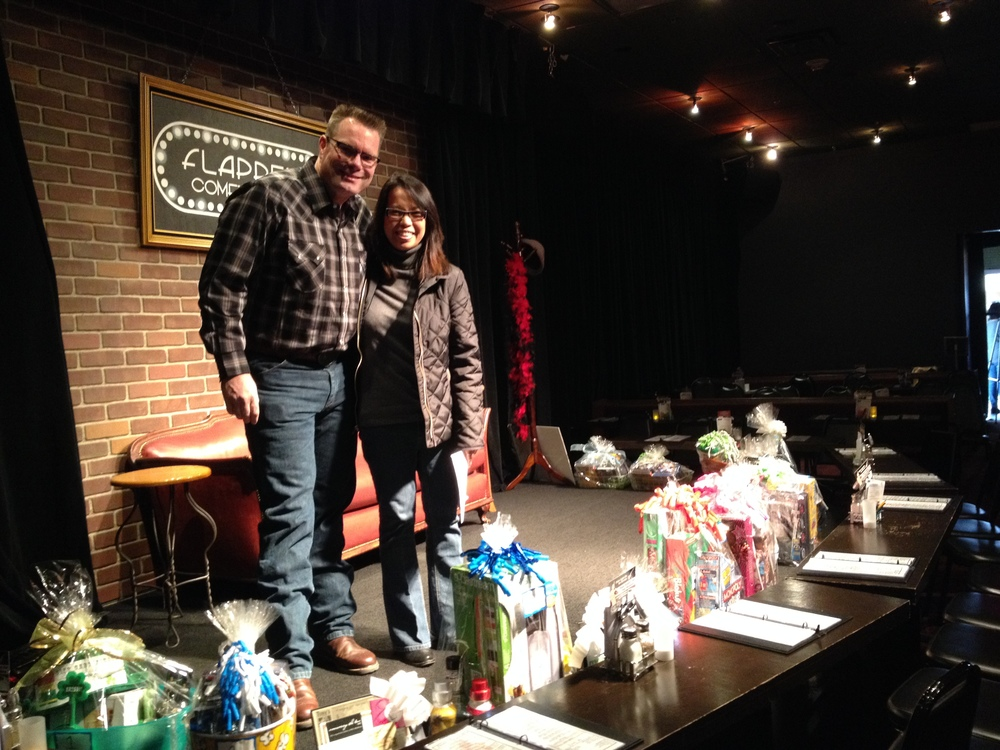 Joy Escalante & Jeff Carlon take the stage to organize the auction items.