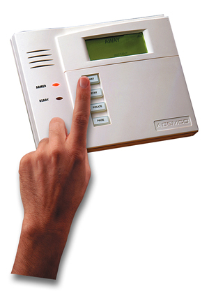 home security system hand touching keypad