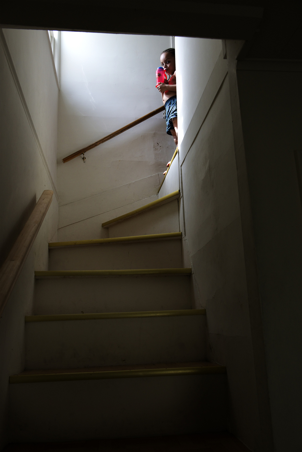 Jesiel Huertas, 4, waits at the top of the stairs for his mom to help him get dressed for school.