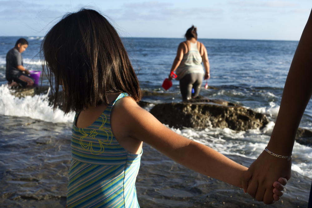 """This is Ivania, known as Panda in her family. """"She looks Chinese!,"""" her mother Marcella said to me. """"But she's just plain Mexican!"""" Ivania and her family were hunting for crabs and waiting for sunset at Sunset Cliffs Natural Park."""