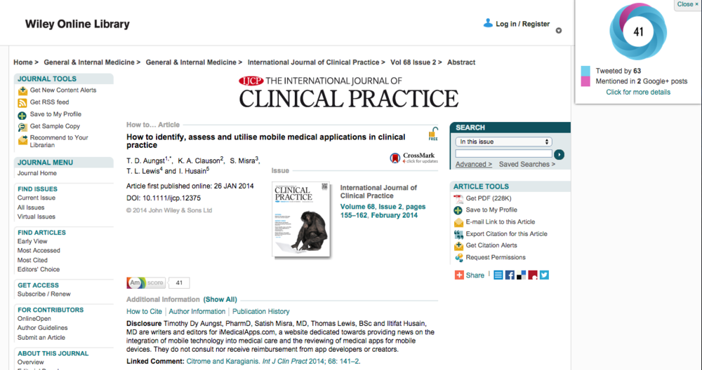 The bookmarklet (upper right corner) shows the Altmetric 'Score' and associated data.