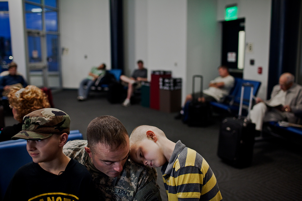 Joey and Issac spend what little time they had left with their father, Sergeant First Class Eisch before his flight departs from Appleton, Wis. Sergeant Eisch has to resume his tour of duty in Afghanistan.