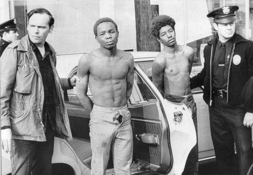 LAPD officers arrest Black Panther members after raid on the party headquarters December 8th, 1969.