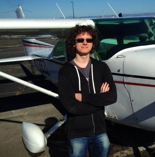 Alexei in front of a plane he can fly.