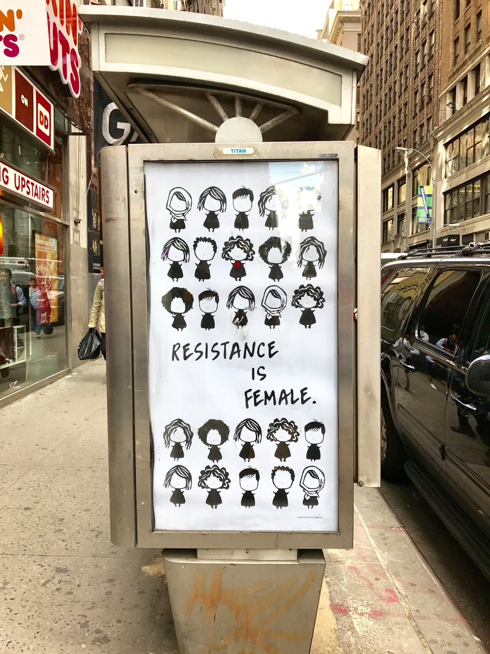 """Resistance is Female"" poster designed as part of "" Resistance is Female ,"" a series of Ad Takeovers featuring women artists and their allies, put up in mid-town Manhattan."