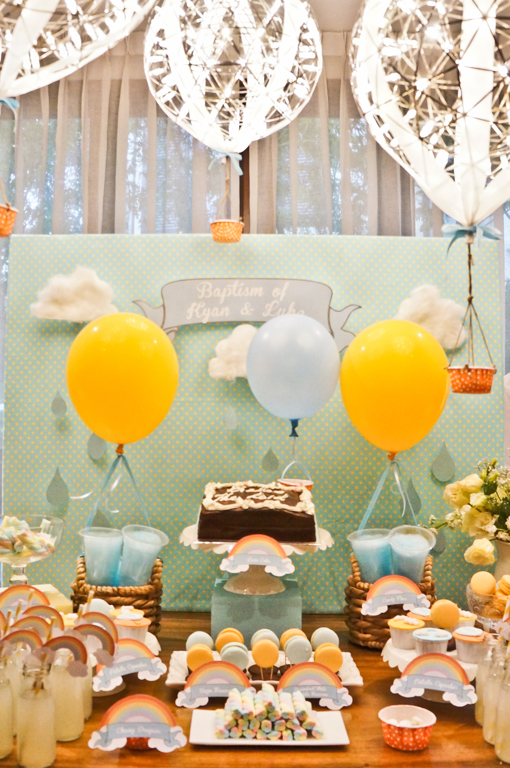 A rainbows and showers-themed dessert buffet. Our very versatile Moooi Raimond lights became hot air balloons!