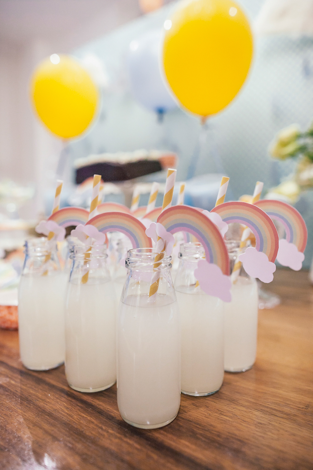 Lemonade jars with rainbow straws