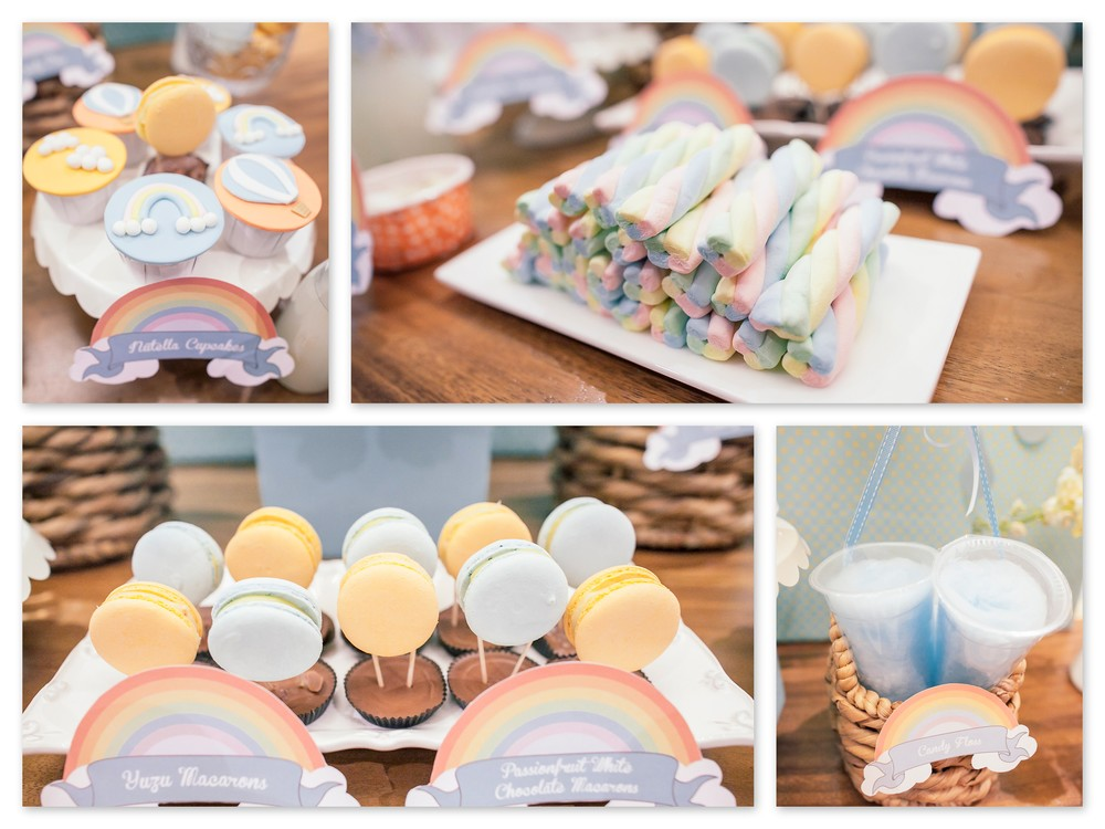A sweet selection of rainbow and cloud cupcakes, marshmallows, macarons and cotton candy.