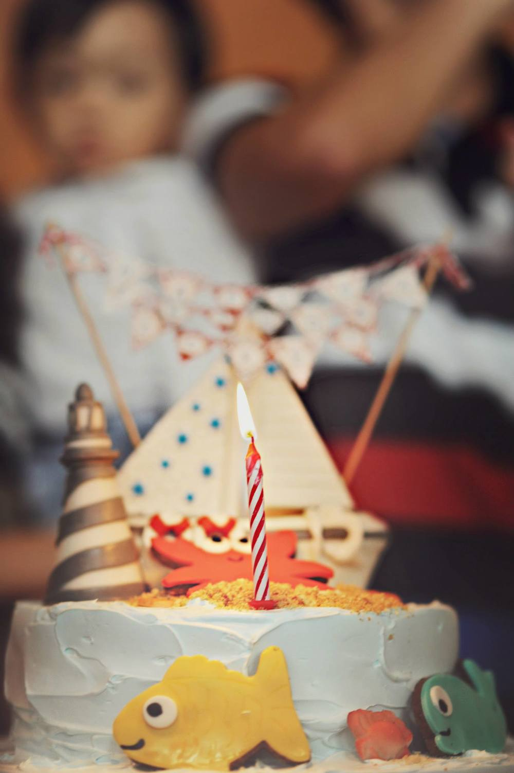 nautical birthday party cake with boat and fish