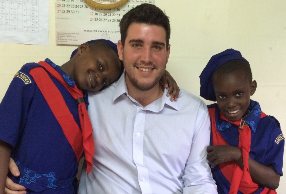 Stephen Fleischer '10 (center) recently returned from Nairobi, where he taught English and math at Our Lady of Nazareth.