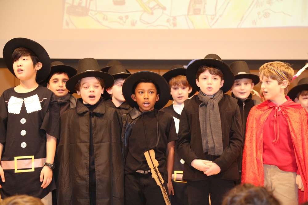 The third graders perform a play about the pilgrims' story of coming to the New World.