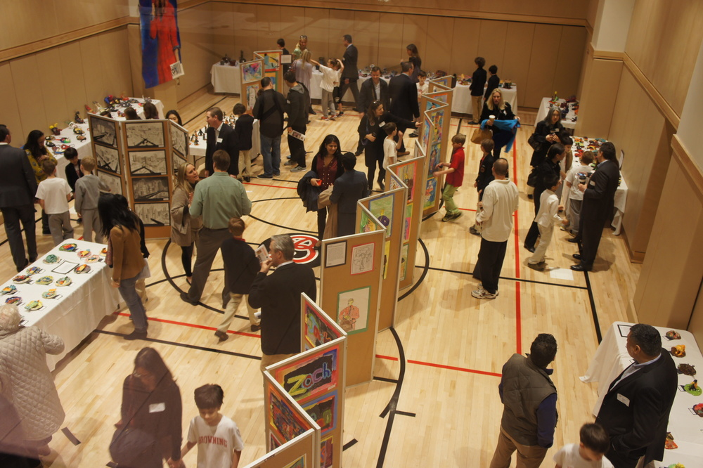 Lower School parents and boys view week-long Art Show in Lower Gym.