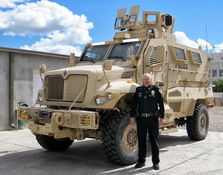 Chief Ken Geddes poses with the Preston, Idaho police department's new MRAP. See Will Grigg's article on this.