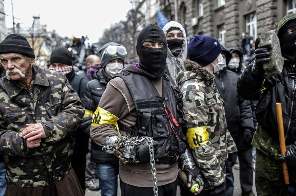 Maidan protesters bearing armbands with the neo-Nazi wolf's hook symbol