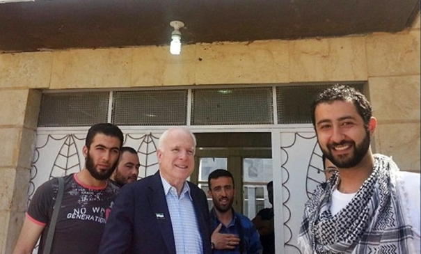 US Senator John McCain with mujahideen from the Northern Storm Brigade.