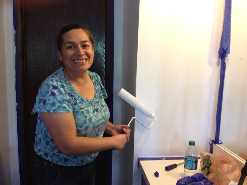 Noticing we had more paint than we needed for the room, Juana applied two new coats to an alcove connecting the bedroom to the bathroom.