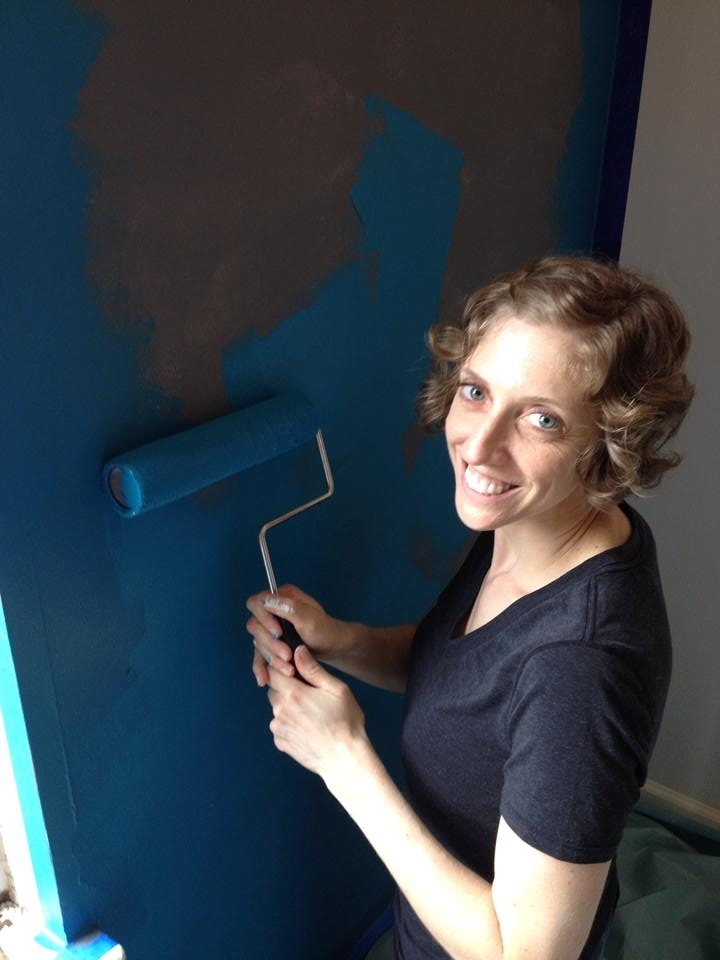 "Maris paints ""W"" formations to most effectively get the paint off the roller and evenly spread onto the wall."