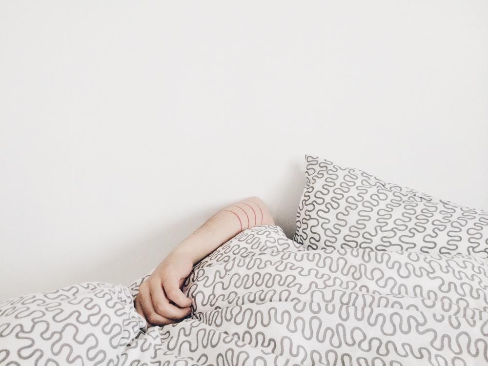 hiding in bed