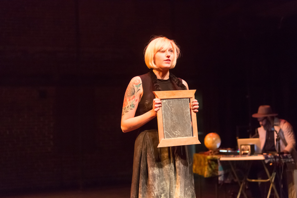 08. Slow Activism December 12, 2014 from TRANSLATIONS at the New Hazlett Theater The translation for theater, with Joanna Reed performing as The Slow Activist who writes a slow manifesto on a piece of slate.