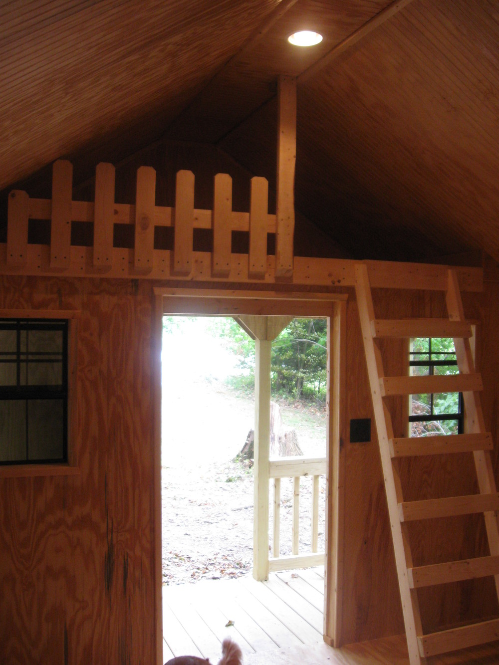 Loft bed above the porch is a great place for the kiddos!
