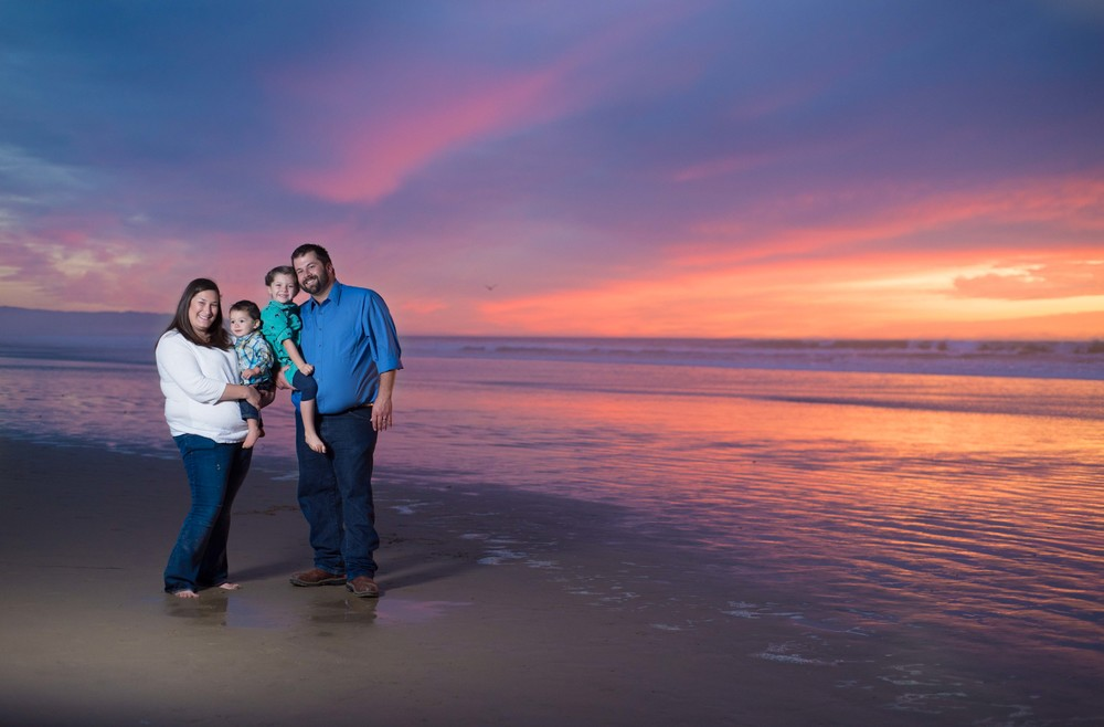 family-portrait-in-front-of-sunset