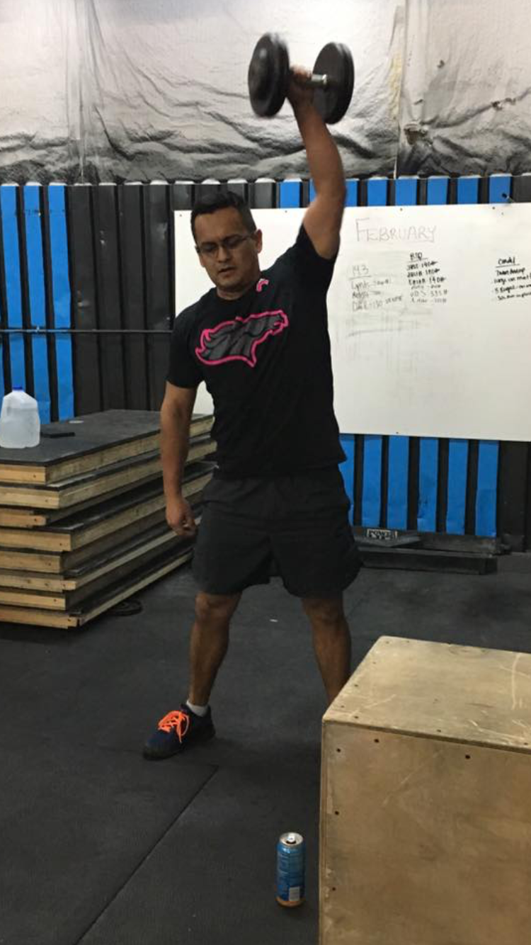 Juan working through dumbbell snatches during Friday Night Lights - 17.1