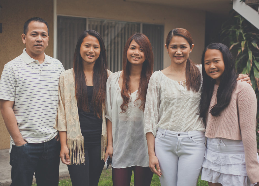 Meet Rita Garcia and family - My name is Rita. My family and I are from General Santos in the Philippines. We came to America for the opportunities—not only for us, but more for our daughters, Camille (17), Katrina (14), and Chloe (10). Like all parents, we want to give them the opportunities we didn't have, and we know that they will be able to make their dreams come true here in America.My daughters are really loving America.Camille is a high school senior and works part time in retail fashion. She would like to be a fashion designer one day. Apart from that, like a true Filipina, she enjoys singing and she regularly posts her renditions of pop songs on youtube, where she enjoys a huge following. Katrina, is a high school freshman and is a multiple varsity athlete, particularly volleyball. She is Top 5 at her school and would like to pursue a science degree in college. Katrina plays the guitar.Chloe is in fifth grade, and is a budding filmmaker who enjoys editing videos. She also loves reading Japanese manga comics and watching anime.We moved to the U.S. only three years ago and we now live in Central Los Angeles where there are many other Filipino families. We often still miss home and the rest of our friends and family back in the Philippines. But we are happy and satisfied with the life we have made here and we are excited to see what the future will bring.