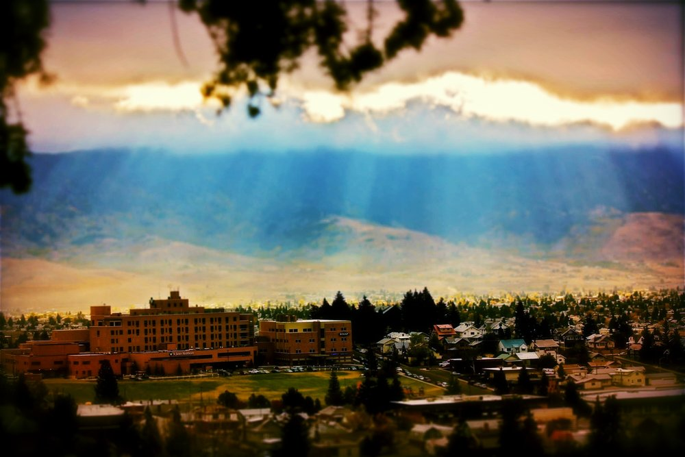 Sun rays filter into the Summit Valley, St. James Healthcare in the foreground  (photo: Chad Okrusch)