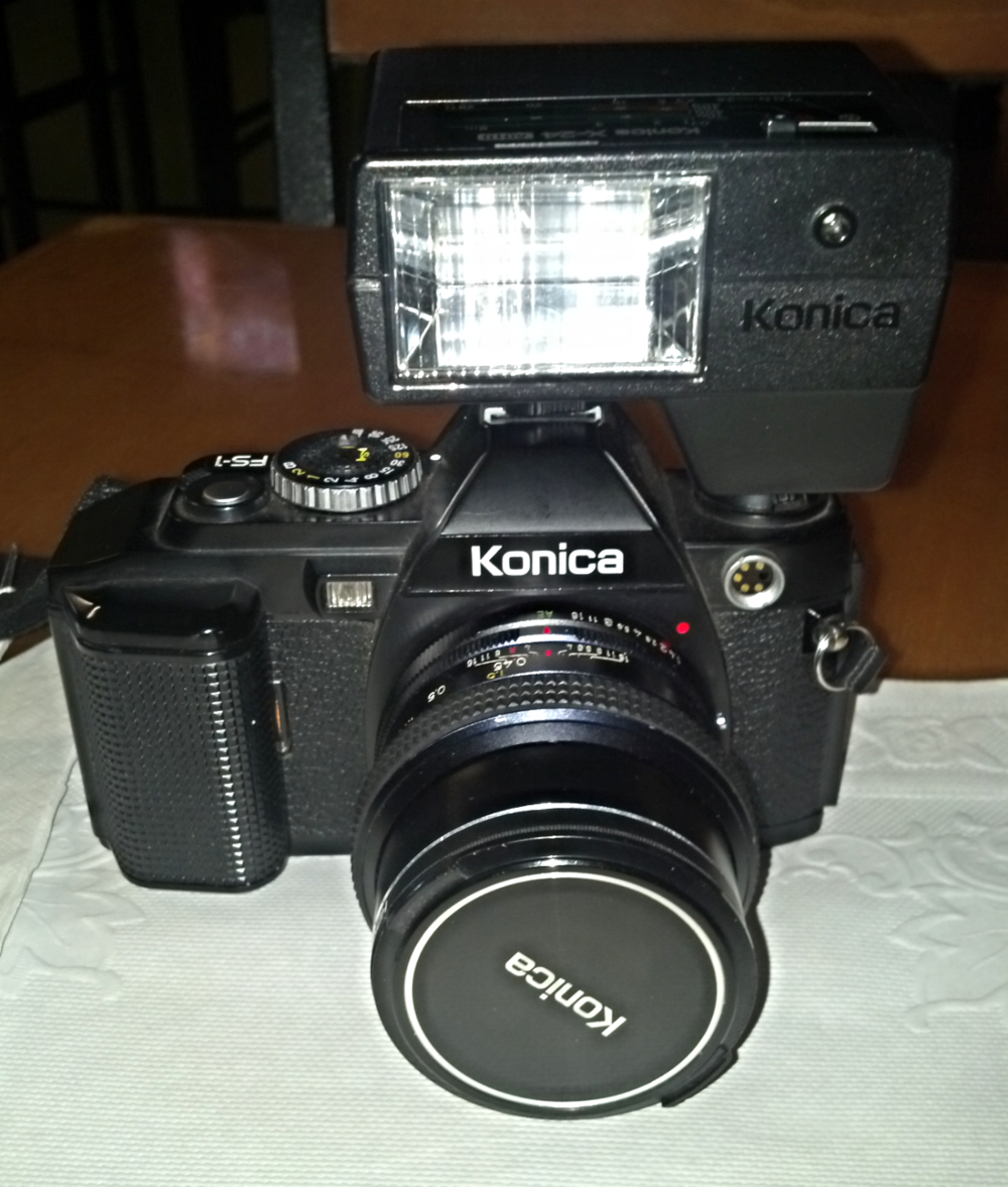 A 35mm Konica FS-1, introduced in 1979.  I'm a big Konica fan, and this model is one of my current favorites.  It was one of the first SLR cameras to feature a motor drive for advancing film.  You do have to rewind  the film manually, however. Konica lenses are still widely recognized as high quality.