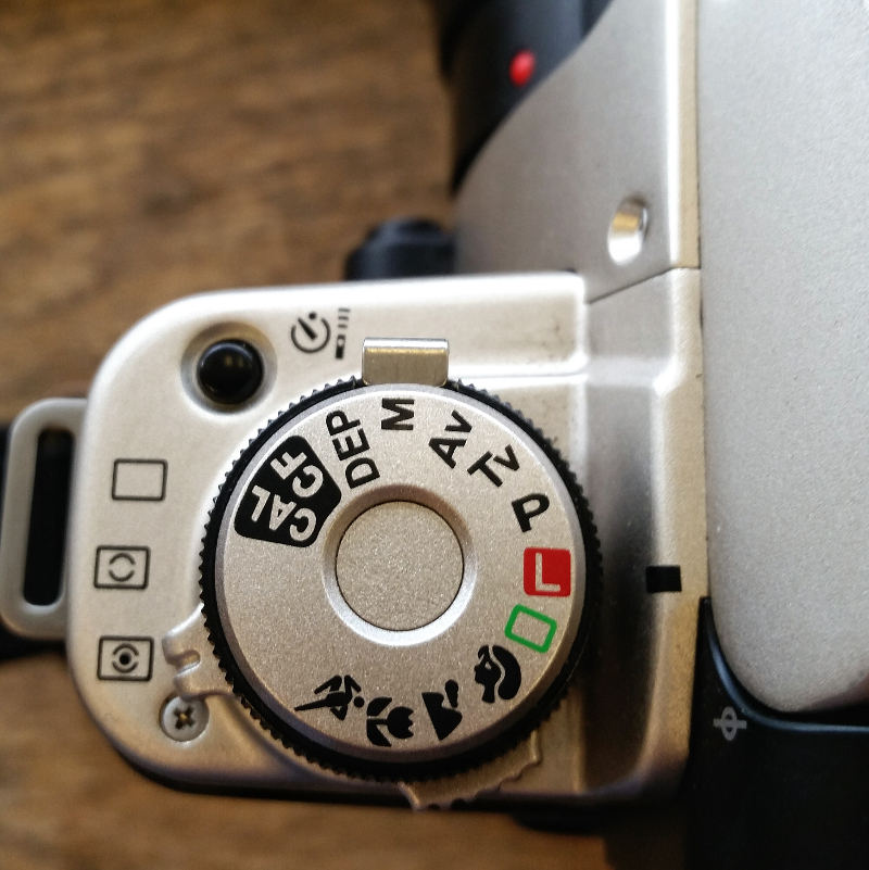 The main dial on a Canon EOS Elan IIe 35mm SLR (mid 90s film camera). While modern Canon DSLRs will have some added settings, the main ones we're concerned about don't change.