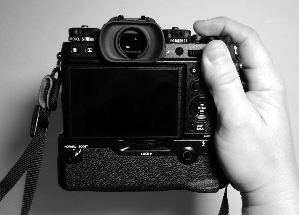 Rearview of the Fujifilm X-T2, with the optional grip attached. If you're a pro, the grip is a must-have accessory. While it adds bulk to the camera, it also houses two additional batteries, bringing the overall exposures per charge on parity with a typical DSLR. A charged grip also boosts autofocus and frames per second.