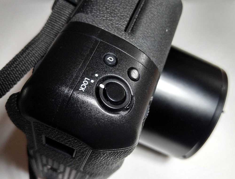 The secondary exposure button on the optional grip, shown in locked position.