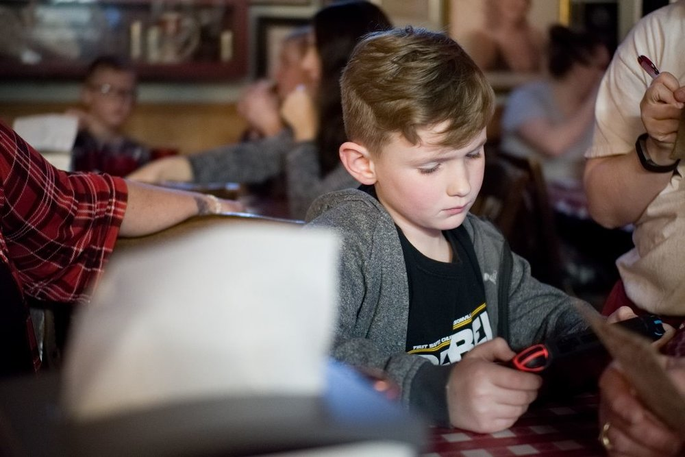 Son of family friends, absorbed in a game. Shot at ISO 6400.