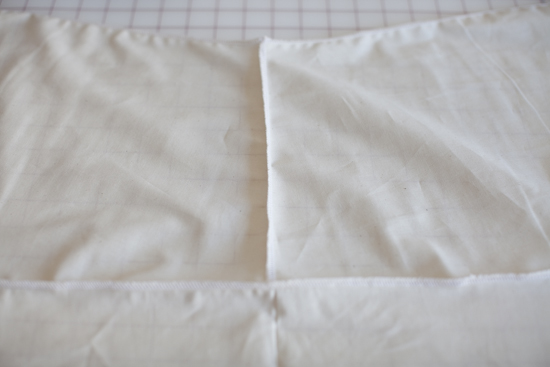Vertical stitching:  The two front pieces serged together.   Horizontal stitching:  The fronts serged to the back piece lining up the stitching with the center back.