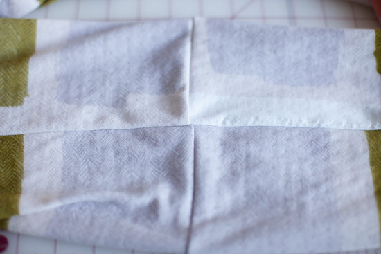 "The short seams ""lined up"", and the long seam horizontal."