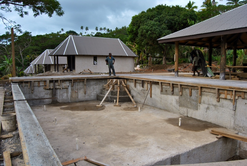 The pool is beginning to look very pool-ish.  Note the infinity edge towards the left of the photo.