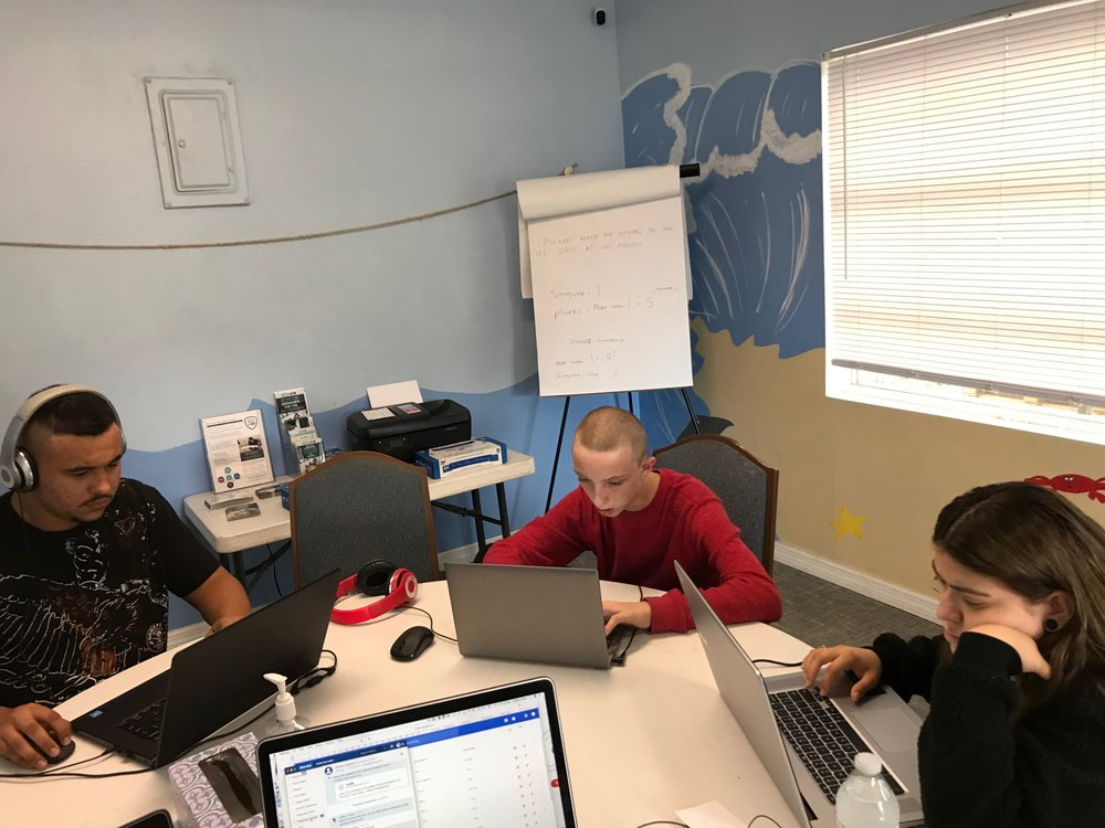 A small learning group working hard at 24/7 Learning Academy
