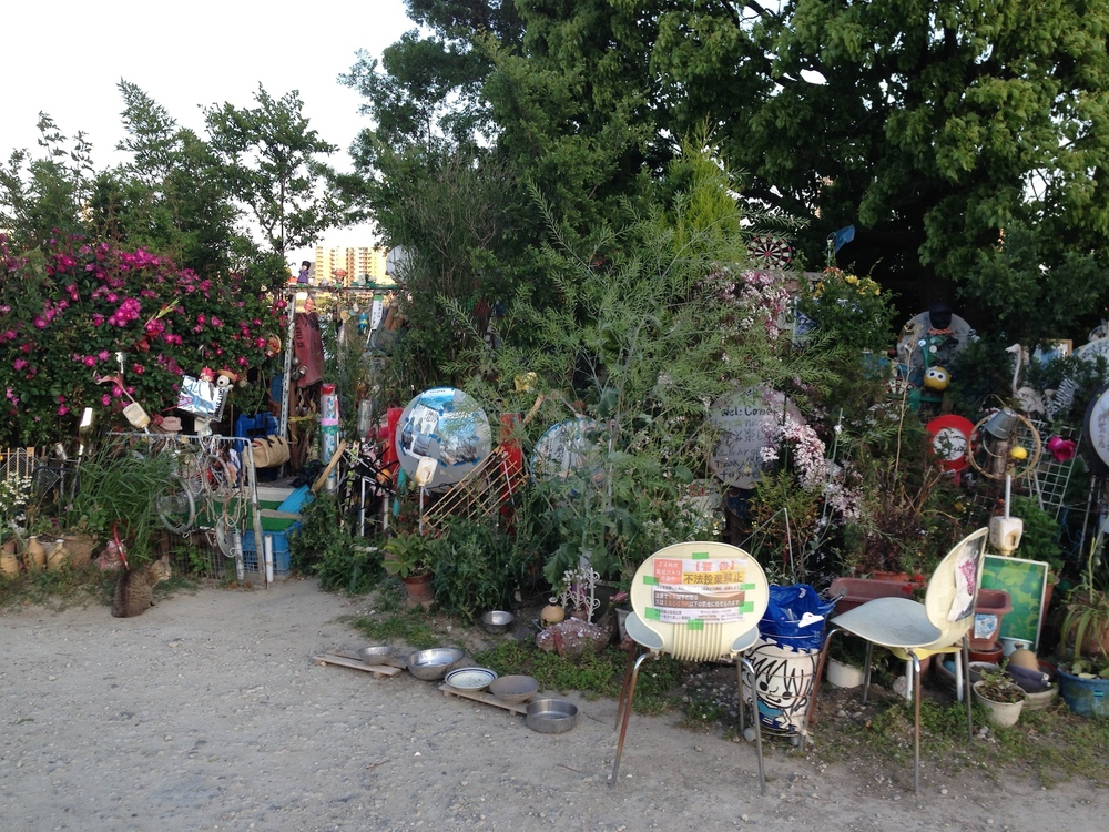 A house by the river in Osaka. It's decorated with trash.