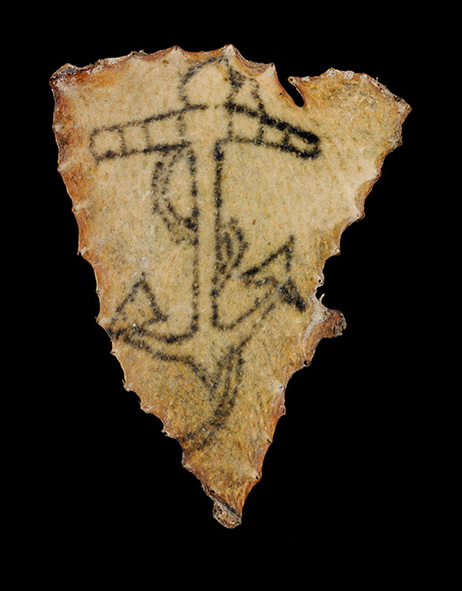 Human skin tattooed with a fouled anchor, circa 1850 - 1890. Image: Convict Tattoos: Marked Men and Women of Australia. Source: Science & Society Picture Library.