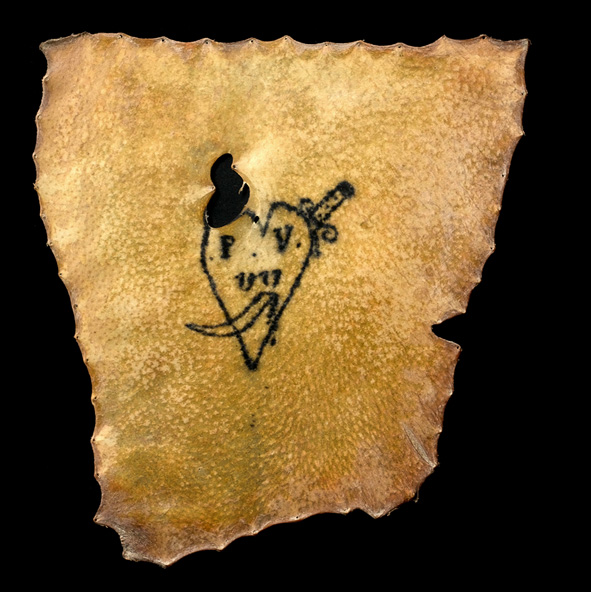Human skin tattooed with a heart pierced with a dagger, and the initials P.V.VV. Believed to be French, circa. 1850-1900. Source: Convict Tattoos: Marked Men and Women of Australia. Image: Science & Society Picture Library.