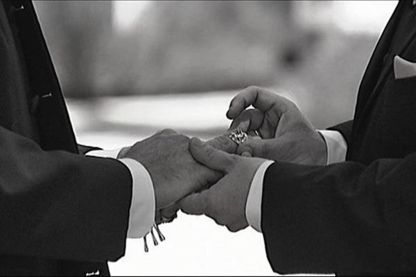 LBGT couple exchanging rings