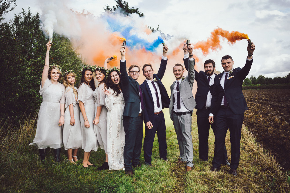 Image of Annie & Calum Worth wedding at Dunmow Church with Smoke Bombs