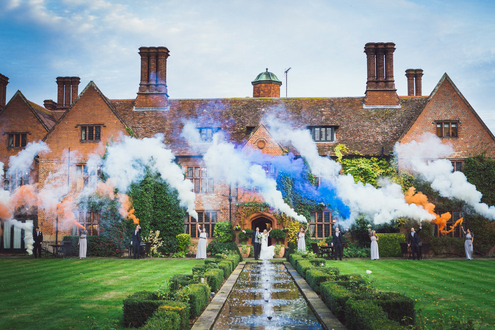 Image of Lacey & Dan Harris' Wedding at Woodhall Manor, Suffolk with Smoke Bombs