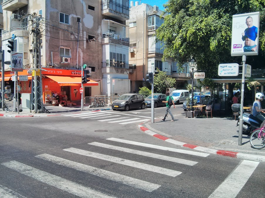 The intersection between Dizengoff (main street) and Bar Giyora (one-way traffic), Tel Aviv.