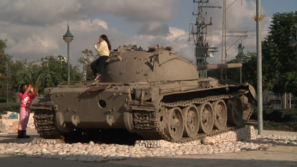 A tank standing as a memorial in a neighborhood in Ofakim
