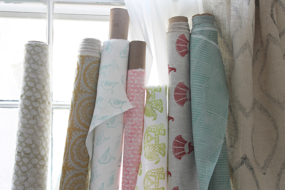 """Introducing 8 new hand-blocked patterns designed, carved and printed by Kari Fisher. All patterns are now available in 9 new colors and 5 new linen grounds. Pictured above from L to R: Greige """"Wabi"""" on Lightweight Natural Linen, Honey """"Orly"""" on Mediumweight Dark Natural Linen, Sea """"Shore"""" on Lightweight Oyster Linen, Gypsy """"Knitch"""" on Lightweight Oyster Linen, Rosa """"Metro"""" on Mediumweight Natural Linen, Malachite """"Rue"""" on Mediumweight Celadon Linen, Ash """"Avant"""" on Sheer Natural Linen."""