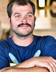 - PAUL ELYSEEV: CO-FOUNDERPaul Elyseev spent the last 40 summers in Ocean Grove, NJ. Paul received a BFA in Glass and Sculpture from Jacksonville University and continued his glassblowing education at Pilchuck Glass School and Penland School of Crafts. Paul also spent a year as a glass apprentice for Master Erwin Eisch — Eisch Factory in Germany and one month working at the Minden Glass Museum.Paul's other full-time job is a project manager for LevelLine Build & Renovations, LLC, 6-time National Rowing Champion, Asbury Park lifeguard for 16 years, and volunteer fireman. He is a life-long summer resident of the Jersey Shore.