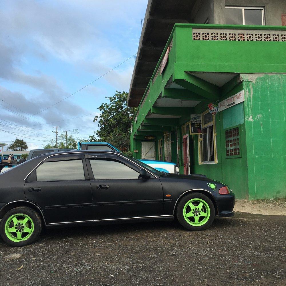 St Lucia Green Wheels Car Building.jpg
